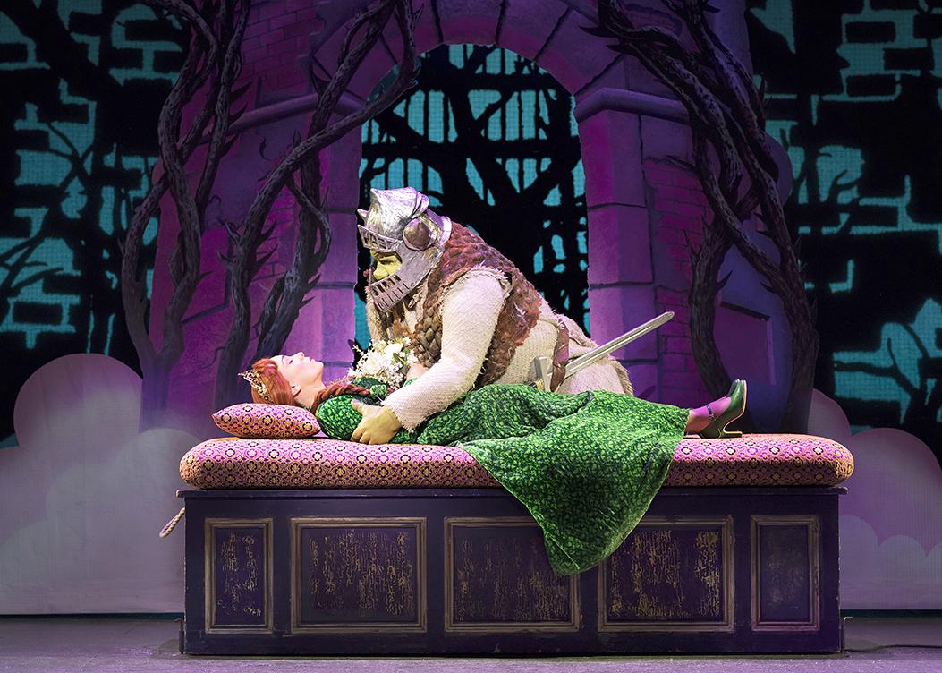 Laura-Main-as-Princess-Fiona-and-Steffan-Harri-as-Shrek.-Shrek-the-Musical.-Credit-Helen-Maybanks
